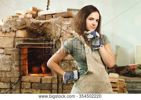 Potter Girl Posing In Authentic Workshop. Female Mastery Concept.