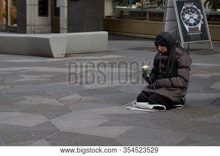 Helsinki, Finland - 3 March 2020: Poor Person On Street, Illustrative Editorial