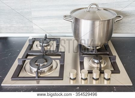 Metal Pot On Induction Hob In Modern Kitchen. Modern Kitchen Pot Cooking Induction Electrical Stove