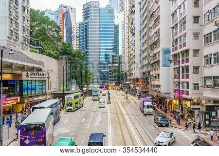 Hong Kong, China - March 16, 2019: 4k Timelapse Video Of Pedestrians And Bus Traffic On A Busy Stree