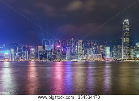 Hong Kong Skyline Cityscape Downtown Skyscrapers Over Victoria Harbour In The Evening. Hong Kong, Ch