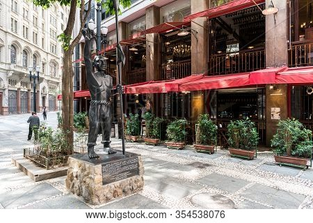 Sao Paulo, Brazil - 15 February, 2020:  Horizontal Picture Of  Black Statue And Restaurants Located