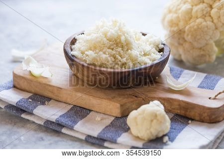 Cauliflower  Flour  And Vegetable On A Cutting Board. Healthy Food.  Cauliflower  Vegan Diet