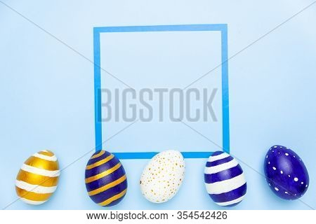 Happy Easter. Frame For Text Made Of Easter Eggs Trendy Colored Classic Blue, White And Golden On Bl