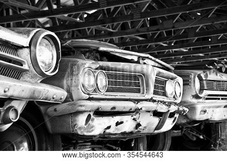 White, Ga / Usa - October 17, 2018: Close-up Image Of The Front Of An Old Cars In A Storage Shed At
