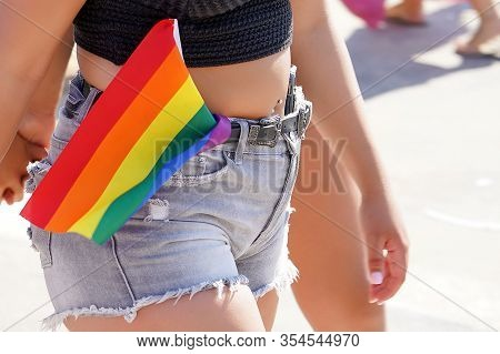 Woman Lesbian Walking In The Gay Pride Parade. Parade Of Tolerance. The Annual Parade Lgbt. Rainbow