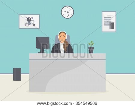 Cozy Call Center Office. Assistant Female With Headphones Sitting At Table With Monitor And Home Pla