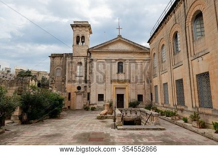 Il-rabat, Mdina, Malta - October 28, 2019: The Entrance To The St. Agatha Historical Complex And Cat
