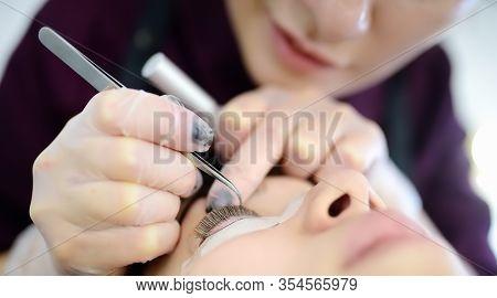 Beautician Making Eyelash Lamination Procedures. Modern Eyelash Care Treatment Procedures - Staining