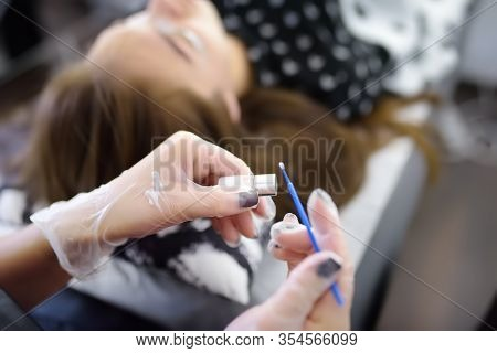 Beautician Making Eyelash Lamination Procedures. Modern Eyelash Care Treatment Procedures - Staining