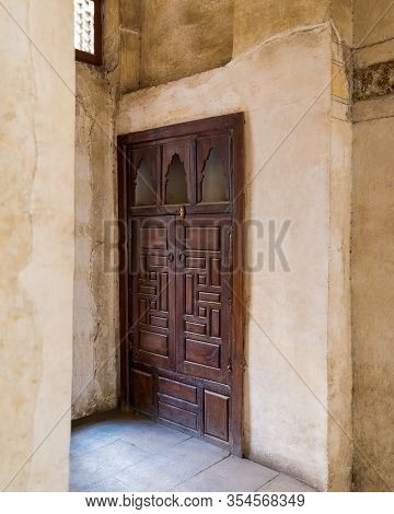 Angle View Of Wooden Aged Door On Grunge Stone Wall, Medieval Cairo, Egypt