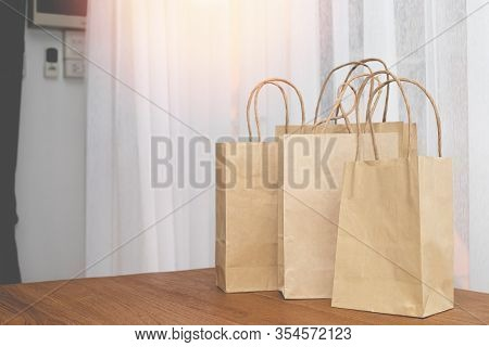 Kraft Paper Shopping Bags On Wood Table, Concept Of Shopping Online.