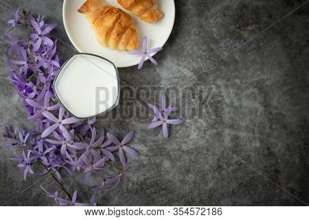 Glass Of Milk On Cement Background, View From Above Table.