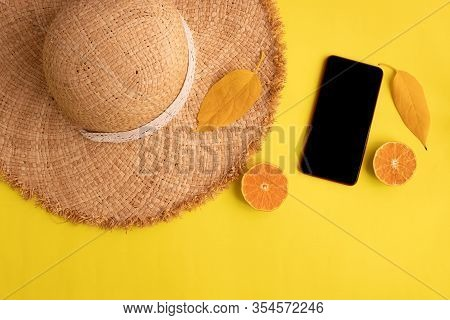 Cocept Of Summer On Yellow Background, Black Screen Smartphone For Text.
