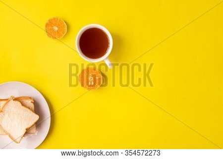 Breakfast Table With Cup Of Tea On Yellow Background.