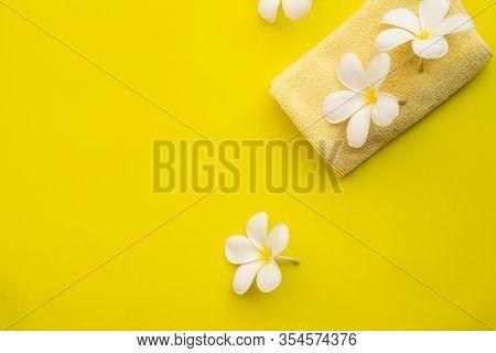 Plumeria Flower On Yellow Background, Concept Of Summer Season.