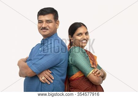 Happy Indian Couples In Traditional Dress With Arms Crossed Standing Back To Back On Isolated Backgr