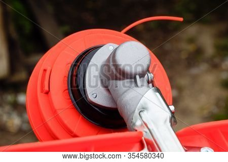 Head With Fishing Line For Mowing Grass. Gas Trimmer. Trimer Gascosis With A Leaf For Mowing Grass A