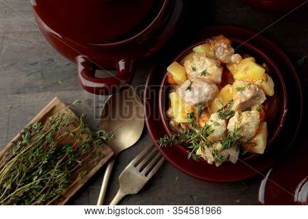Irish Stew Sprinkled With Green Thyme.  Meat Stewed With Potatoes, Carrots And Spices On Wooden Back