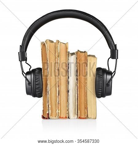 Audiobook Concept. Stack Of Books And Headphones Isolated On White Background