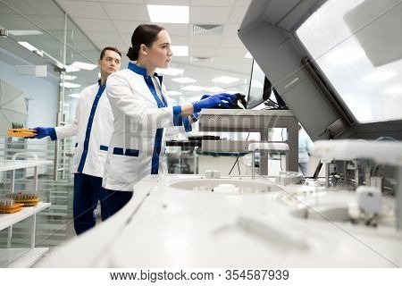 Research Scientists Working In Laboratory With Modern Equipment