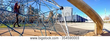 Barcelona, Spain - February 5, 2014: Active Little Girl On A Playground With Net Rope Climbing Equip