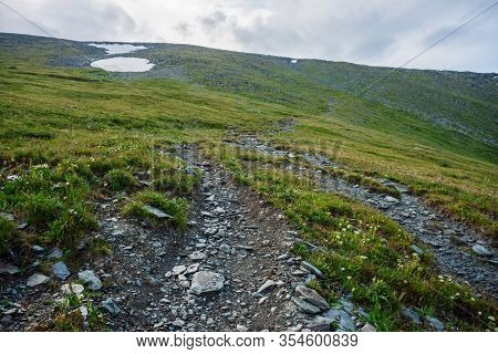 Hiking Path Through Mountains. Trekking Mountain Trail. Atmospheric Minimalist Alpine Landscape With
