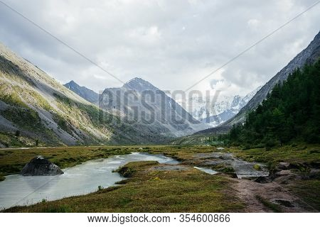 Awesome Alpine View To Mountain Lake And Great Glaciers Under Gloomy Sky. Dark Atmospheric Highland