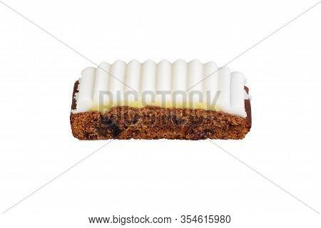 Isolated Slice Of Fruitcake With White Icing On A White Background