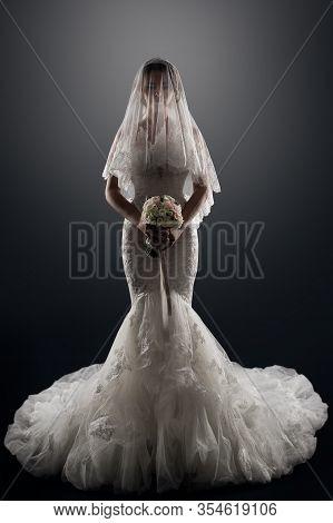 Wedding Bride In Veil On Face, Elegant Lady In Luxury Bridal Dress, Studio Portrait
