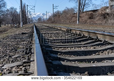 Railroad With Rails And Mountains Background.railroad With Rails And Mountains Background