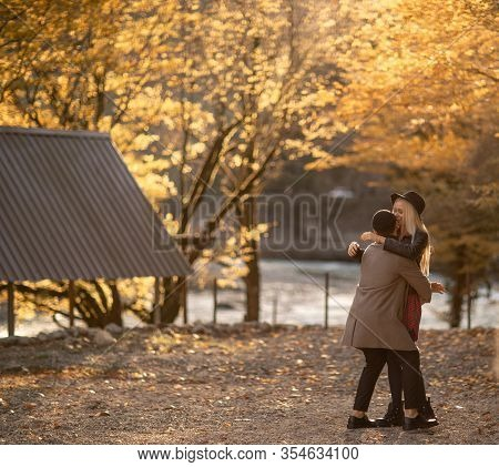 A Pair Of Men And Women Walk Together And Cuddle.