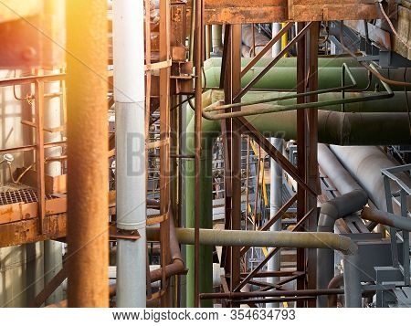Tangle Of Pipes. Concept Of Complexity Of Petrochemical Industry Communications. Pipe Weaving Of Var