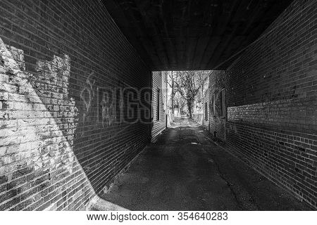 Burlington, New Jersey - March 4: Bright Sun And Dark Shadow Through This Old Brick Alleyway On Marc