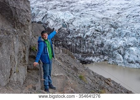 Happy Tourist Looking At View Iceberg Landscape With Giant Icebergs And Lake.iceland