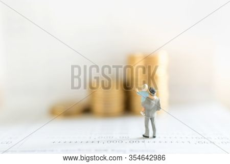 Business, Money, Saving, Security And Family Concept. Close Up Of Father And Child Standing On Bank