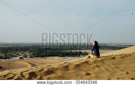 Single Young Asian Girl Enjoy The Beautiful Desert View On Sand Hill At Mingsha Mountain And Crescen