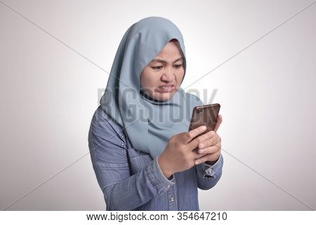 Portrait Of Muslim Hijab Talking Texting On Phone, Angry Upset Disappointed Expression Having Bad Ne