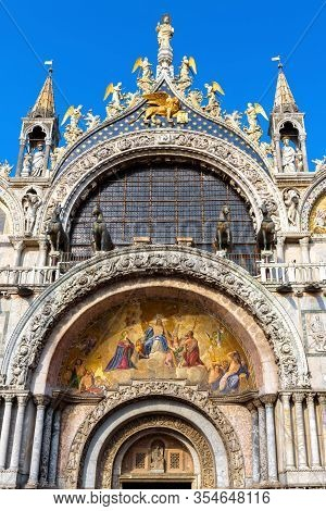 St Mark's Basilica In Venice, Italy. Front View Of Main Portal. Famous Saint Mark's Church Is Top La