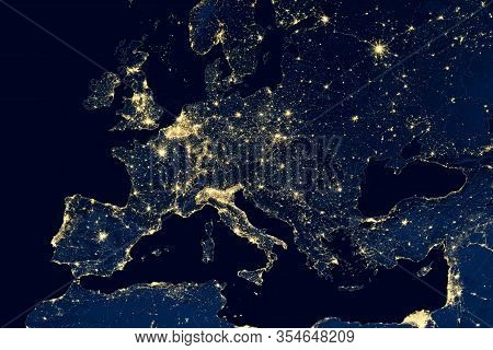 Earth At Night, View Of City Lights Showing Human Activity In Europe From Space. Eu And Mediterranea
