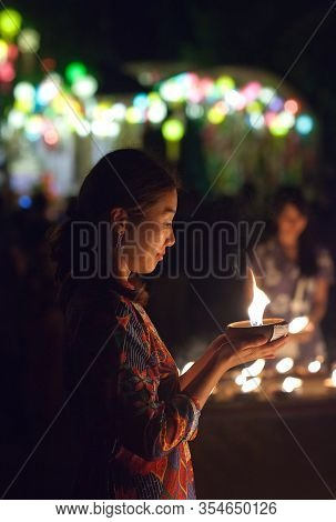 Chiang Mai, Thailand - November 9, 2019: Asian Chinese Woman Light The Candle To Pray In Loi Krathon