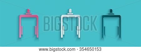 Paper Cut Metal Detector In Airport Icon Isolated On Blue Background. Airport Security Guard On Meta