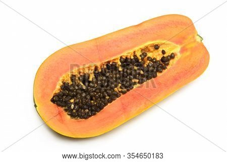 Half Cutted Off Ripe Tasty Papaya Fruit With Juicy Orange Pulp Indoor Studio Photo Isolated On White