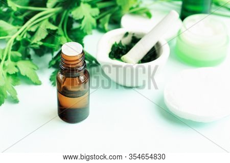 Parsley Extract Herbal Skin Care, Fresh Green Plant With Aroma Bottle, Mashed Leaves In Mortar, Maki