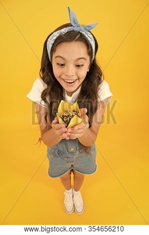 Happy Childhood. Kid Girl Hold Glazed Muffins. Cafe Restaurant Food. Vintage Girl Muffin Yellow Back