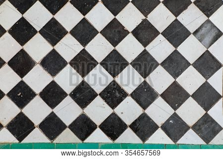 Black And White Ceramic Tiles In Checkerboard Pattern