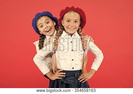 Fashion Trends Every Girls Needs For Back To School. Happy School Kids With Fashion Look On Pink Bac