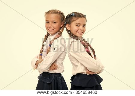 Cute But Smart. Adorable Little Girls Smiling Isolated On White. Happy Small Girls Wearing School Un