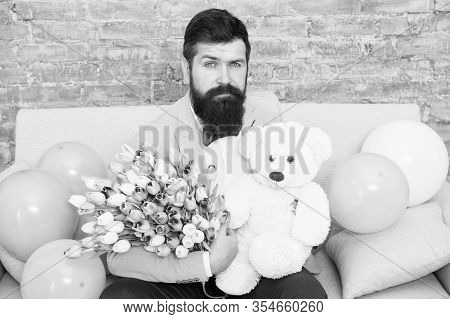 Man Well Groomed Wear Tuxedo Bow Tie Hold Flowers Tulips Bouquet And Big Teddy Bear Toy. Invite Her