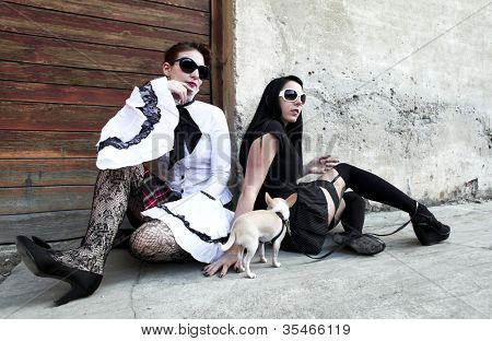 modern punk fashion, portrait of two models posing In vintage clothes